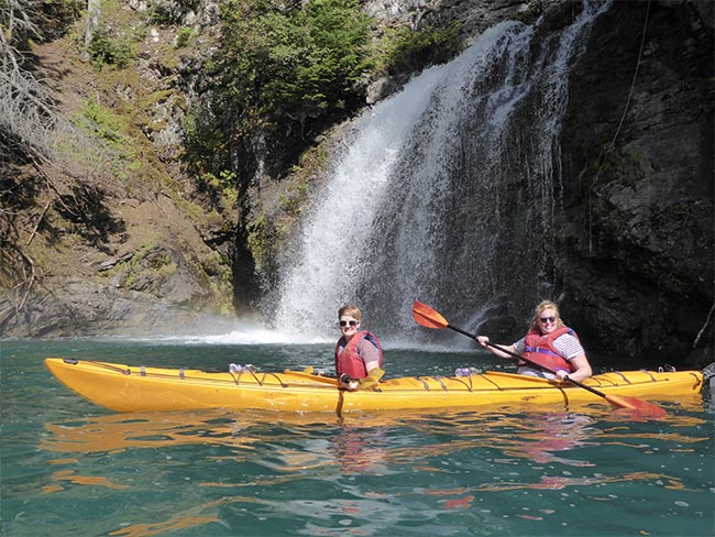 Happy paddlers on waterfall tour with Silver tip Falls